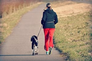 dog and lady exercise on leash